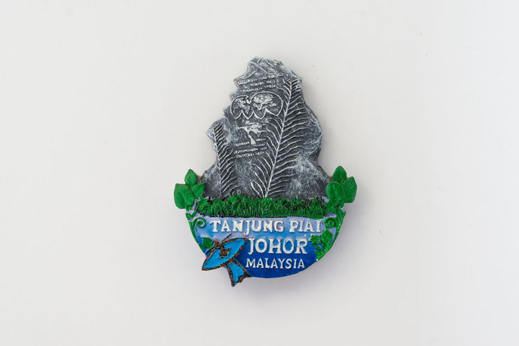 Fridge magnet, Tanjung Piai Johor Malaysia. Text White Background Studio Shot Communication Western Script Copy Space Green Color Indoors  No People Representation Creativity Art And Craft Close-up Cut Out Human Representation Celebration Still Life Craft Fridge Magnets Souvenir Tanjung Piai Johor