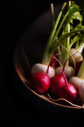 Fresh from the garden Whiteraddish Radish Food Food And Drink Healthy Eating Red Fruit Freshness Still Life Close-up Wellbeing Indoors  Cherry No People Table Black Background Berry Fruit Vegetable Radish Nature Plant Stem Focus On Foreground
