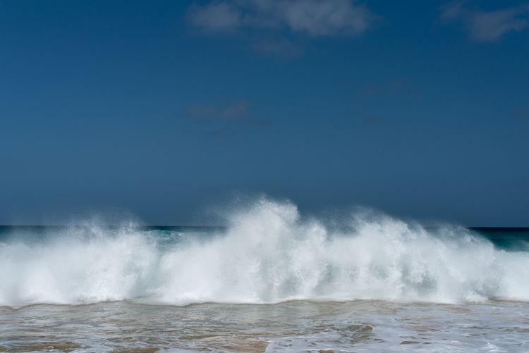 Hoffi99 Cape Verde Waves Atlantic Ocean Strong Waves Sea Water Motion Power Power In Nature Beauty In Nature Wave Sky No People Horizon Scenics - Nature Nature Beach Horizon Over Water Day Outdoors Cloud - Sky Land Blue Breaking Hitting