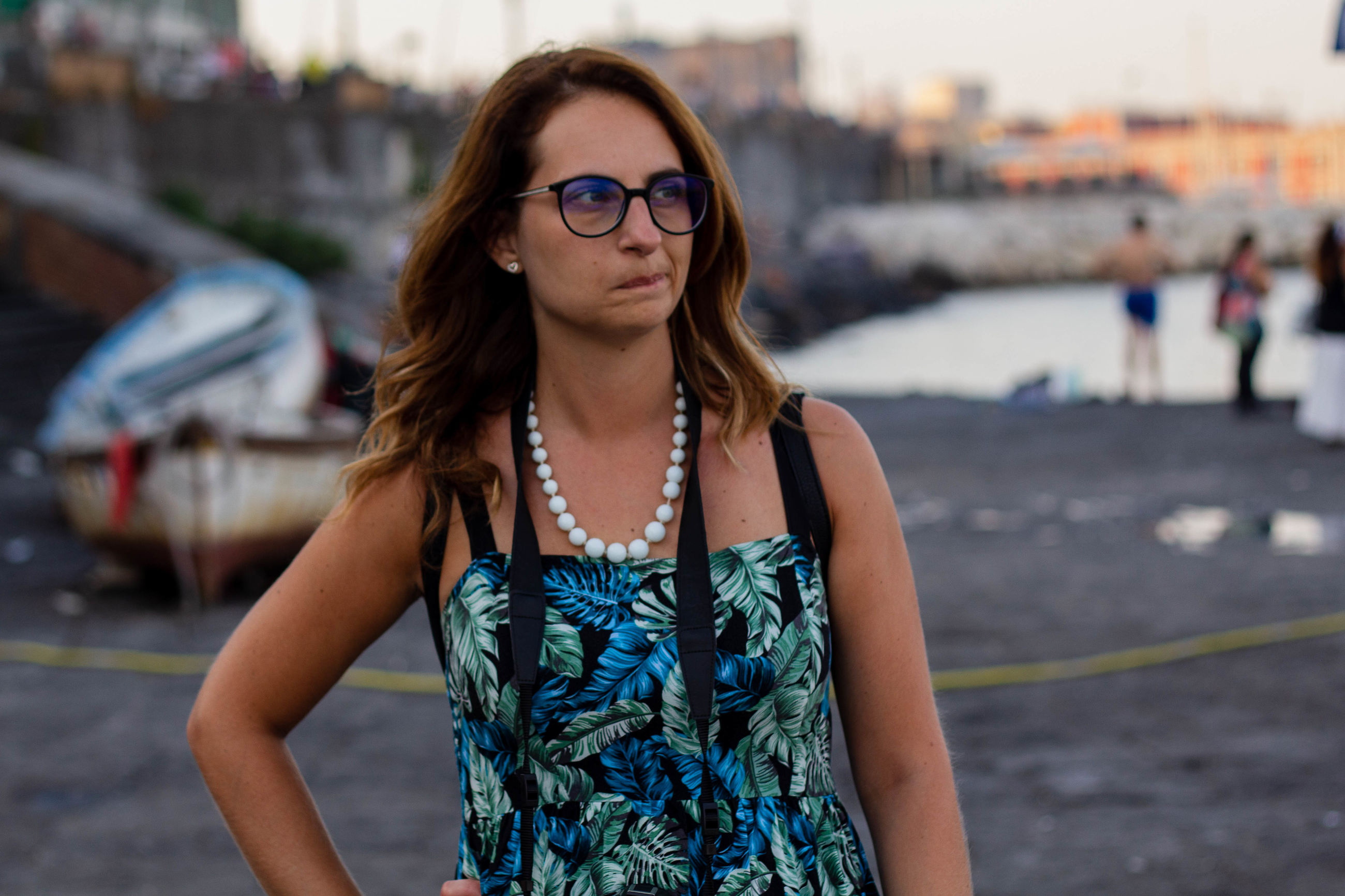 glasses, one person, focus on foreground, front view, young adult, fashion, waist up, young women, real people, brown hair, hairstyle, eyeglasses, lifestyles, hair, leisure activity, beauty, long hair, adult, beautiful woman, outdoors