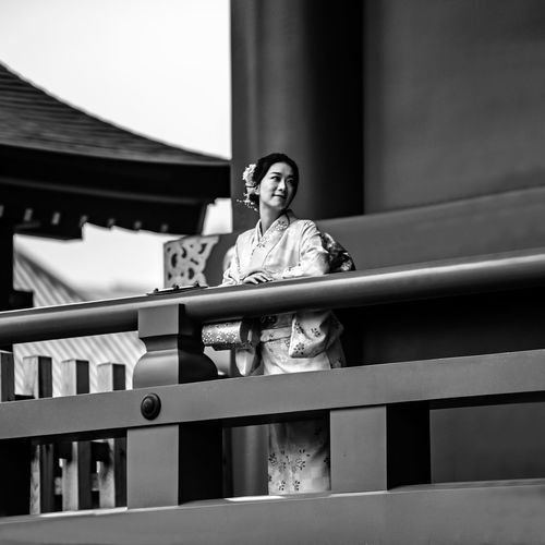 """""""The Lady of the Temple"""" Railing Real People One Person Lifestyles Architecture Leisure Activity Front View Built Structure Casual Clothing Standing Day Focus On Foreground Young Adult Low Angle View Women Portrait Three Quarter Length EyeEm Best Shots Geisha EyeEm Selects Japan Photography The Portraitist - 2019 EyeEm Awards The Portraitist - 2019 EyeEm Awards"""