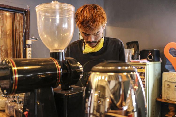 Portrait of man working at kitchen