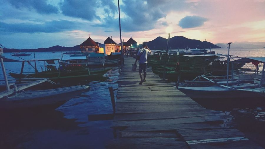 Day 1 in Coron: sunset by the pier Pier Boat Sky Nature Colour Of Life Eyeem Philippines Relaxing Nature Tripping Landscape Itsmorefuninthephilippines Enjoying Life Darkness And Light Travel Photo Mobileshot Philippines Palawan2016 Island Life Coron Sea Sunset Travelphotography People And Places