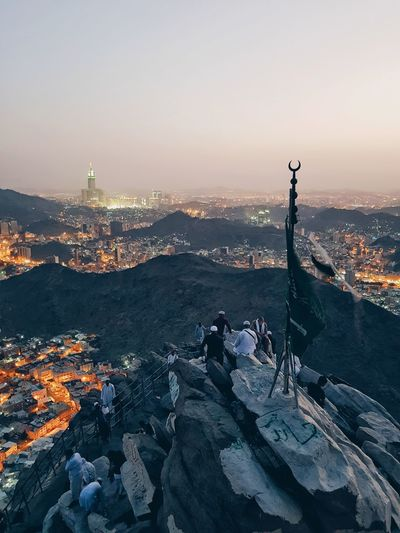 a view from the top of Jabal Al Nour (the mountain of light) where the holy Qur'an first came to yhe prophet Muhammad PBUH Mountain Top Makkah KSA People Islam City Cityscape Urban Skyline Cold Temperature Winter Sunset Illuminated Lake Skyscraper