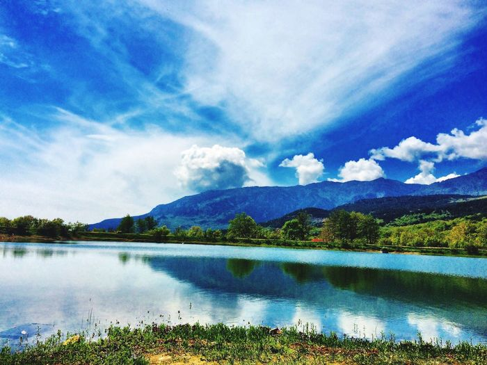 Sky Tranquil Scene Nature Reflection Blue Scenics Beauty In Nature Tranquility Water Outdoors Tree Lake Idyllic Mountain Landscape No People Non-urban Scene Day Cloud - Sky Travel Destinations