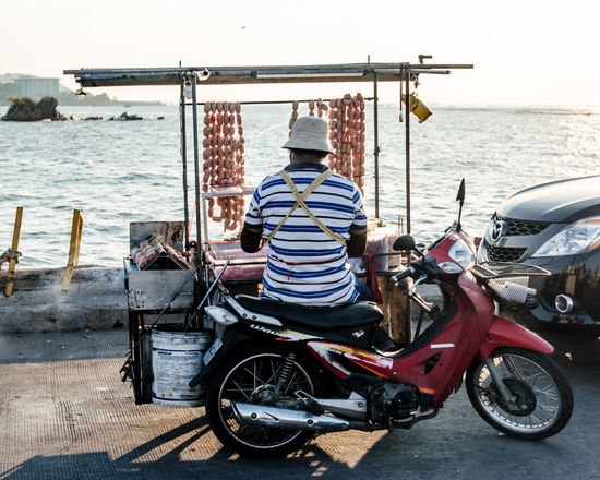 Motorcycle with Thai street food (Grilled sausage) Air Day Food Food Truck Land Vehicle Lifestyles Men Mode Of Transport Motorcycle Occupation Parked Parking Preparation  Sausage Sea Selling Sitting Stationary Thai Food Thai Street Food Thai Style Transportation Transportation