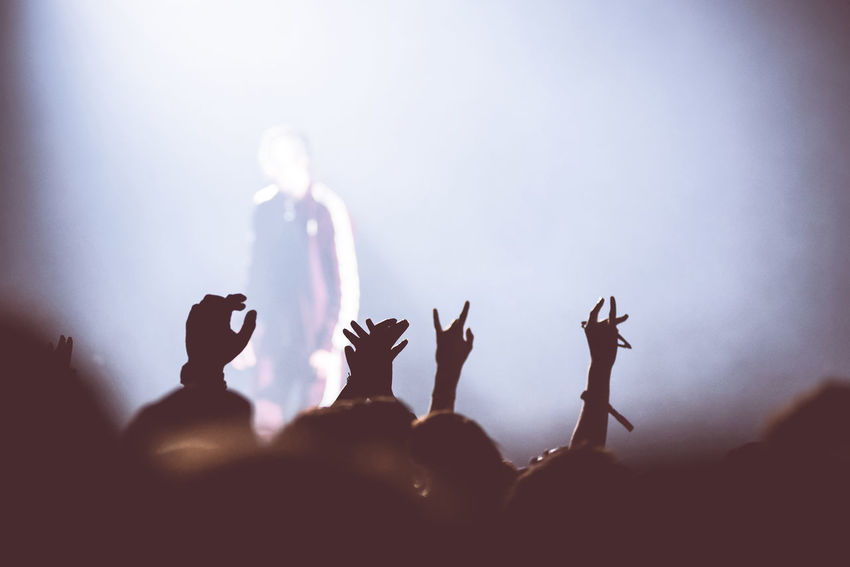 Crowd rocking during a concert with raised arms. Rear view of crowd with arms outstretched at concert Celebration Dancing Event Hands Happiness Music Partying Stage Lights Arts Culture And Entertainment Cheerful Cheering Concert Crowd Crowd Of People Crowded Discotheque Entertainment Festival Music Brings Us Together Music Festival Party People Raised Arms Real People Unrecognizable