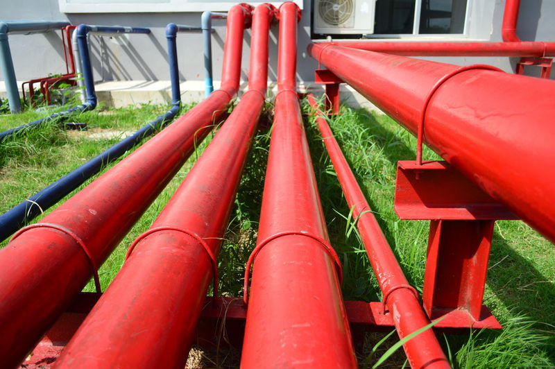 Large red iron plumbing pipes behind the skyscraper like a vein in the human body. Exterior Iron Red Behind The Buildings Bodyart Building Exterior Decoration Decorative Design Exterior Building Exterior Design House Human Human Body Part Interior Design Large Long Pipes Needs Pipes Plumbing Red Plumbing Pipes Skyscraper Strong Veins Water
