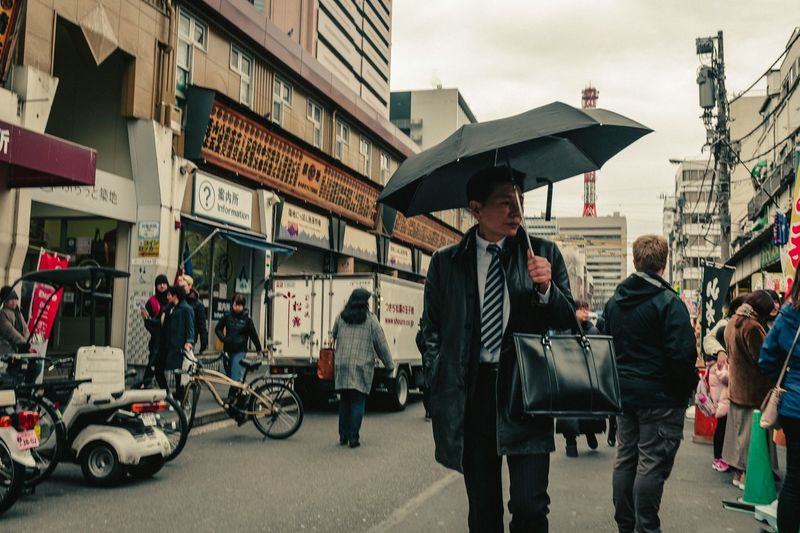 Architecture City Group Of People Building Exterior Men Transportation Built Structure Street People Day City Life Umbrella