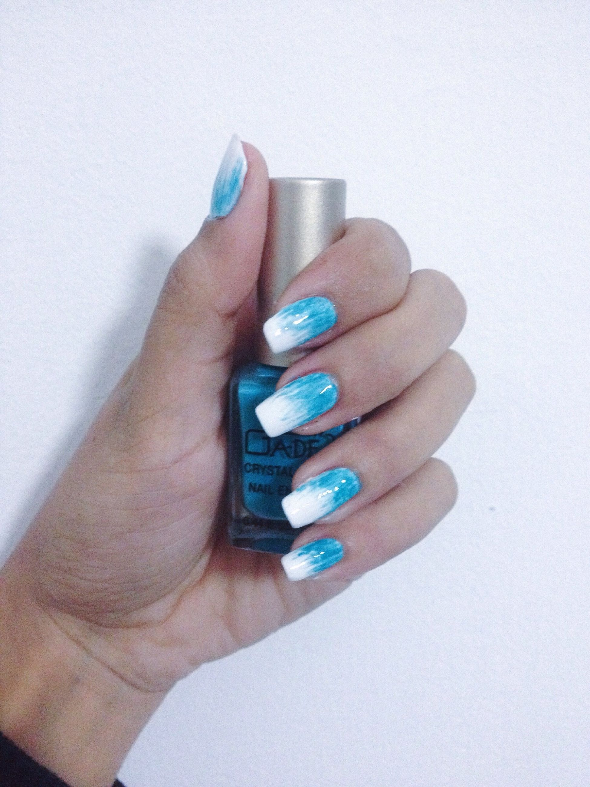 person, holding, part of, human finger, cropped, indoors, close-up, personal perspective, studio shot, unrecognizable person, multi colored, nail polish, white background, showing, leisure activity, high angle view, lifestyles