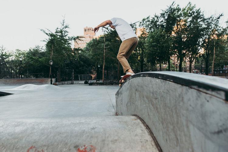 Man skateboarding on skateboard park