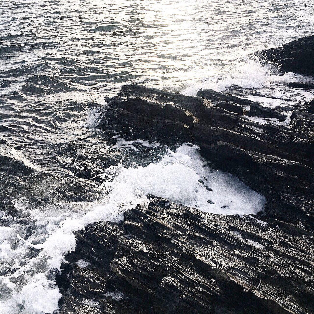 HIGH ANGLE VIEW OF WAVES ON SEA