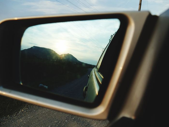 It's all a matter of perspective Mountain Car Mode Of Transportation Vehicle Interior Land Vehicle Motor Vehicle Glass - Material Sky Reflection Side-view Mirror No People Sunlight Travel Sunset Car Interior Nature