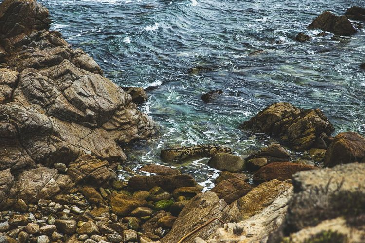 High angle view of rocks in sea