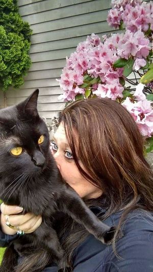 Pets One Animal Domestic Animals Flower Animal Body Part Beautiful People Mammal Young Adult Dog Pink Color Domestic Cat Adult Beauty One Woman Only Portrait Adults Only Young Women One Young Woman Only Women One Person Dreamscapes & Memories Expressive Eyes Cats 🐱 Black Cats Are Beautiful