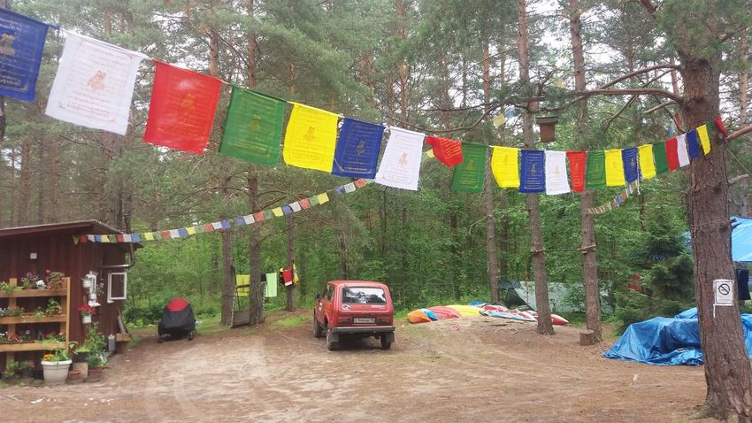 Camp Lena, Losevo, Russia. Flag Land Vehicle No People Outdoors Tree Multi Colored Russia Россия Sommer Summer Russland Sportjugend Hessen Sportjugendreise EyeEmNewHere Sportjugend Losevo Zeltlager Camp Natur Lost In The Landscape Travel Destinations Nature Beauty In Nature Vehicles At The Background