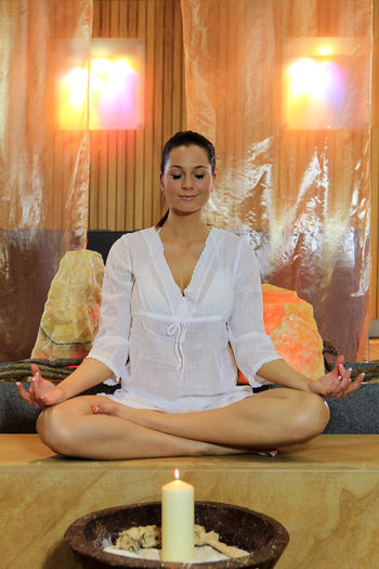 Young Woman Meditating In Spa