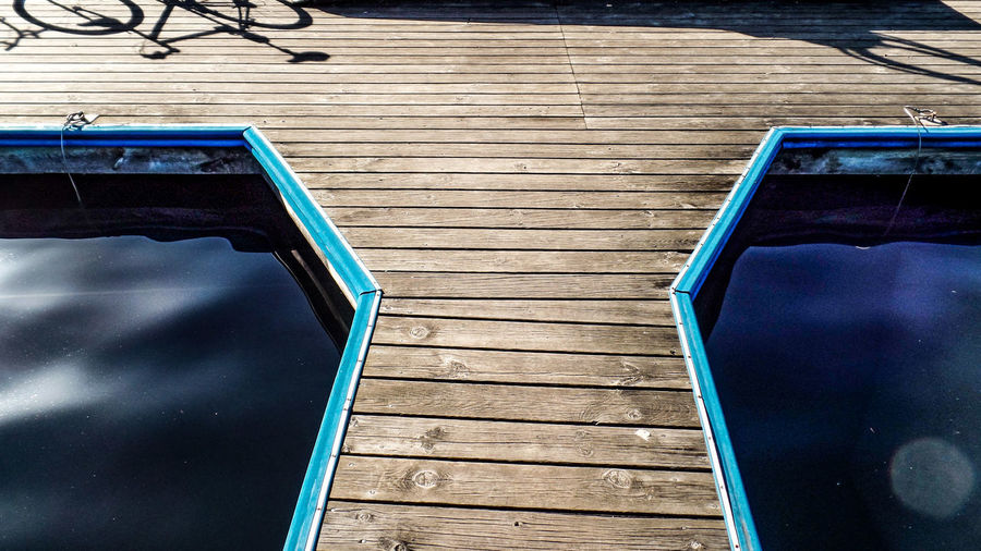 Wood - Material High Angle View Water Blue No People Day Wood Nature Seat Pier Outdoors Railing Reflection Empty Staircase Pool Chair Boardwalk Swimming Pool Wood Paneling