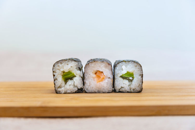 Close-up of sushi on serving board