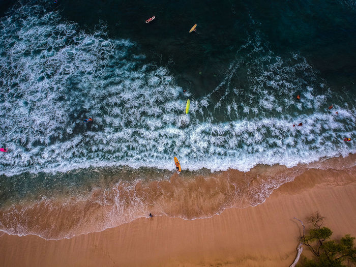 High Angle View Of People Enjoying In Sea