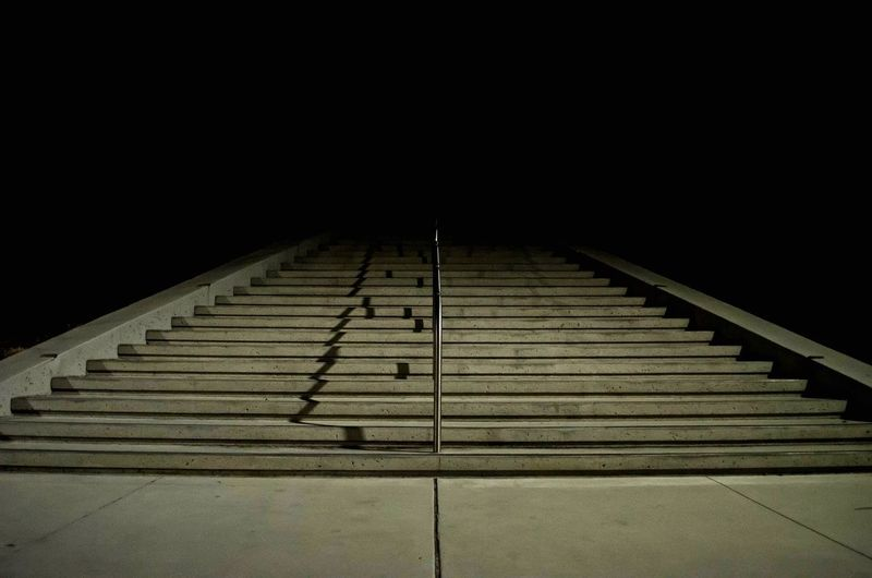 Stairway into the dark Dark Night Staircase Steps And Staircases Architecture Railing No People Low Angle View Built Structure Outdoors The Way Forward Diminishing Perspective Shadow