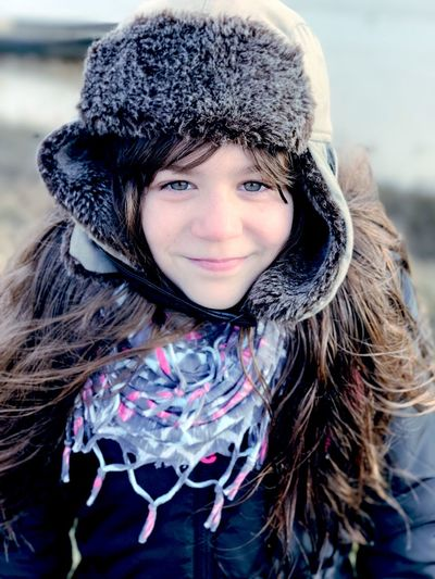 Portrait of a girl wearing a winter hat Looking At Camera Warm Clothing Portrait Cold Temperature Smiling Winter One Person Real People Lifestyles Snow Close-up Childhood Happiness Outdoors Day Fur Hat Human Body Part Gap Toothed People Girl IPhone7Plus