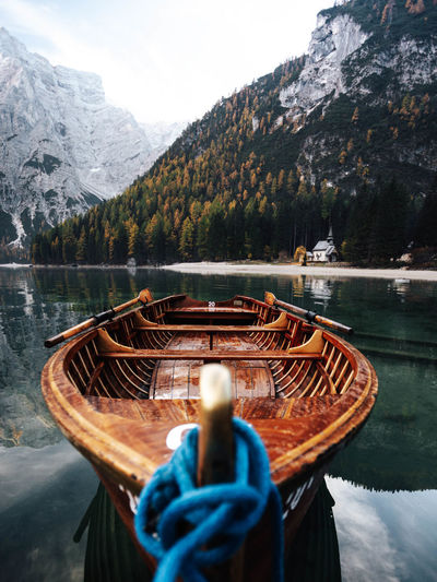 Mountain Water Nature Nautical Vessel Transportation Lake Scenics - Nature Mountain Range Day Mode Of Transportation No People Beauty In Nature Tranquil Scene Reflection Moored Non-urban Scene Tranquility Wood - Material Outdoors Boat Nature Italy Dolomites, Italy Landscape_Collection Dolomites