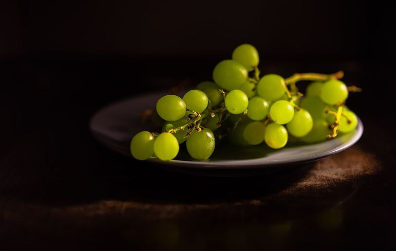 Grapes Foodporn Foodphotography EyeEm Selects EyeEm Best Shots First Eyeem Photo Hello World Still Life Freshness Food Food And Drink Indoors  Green Color Wellbeing Healthy Eating Black Background No People Table Studio Shot Grape Fruit Selective Focus Green Pea Large Group Of Objects Plate Close-up
