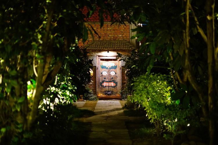Illuminated entrance of building at night