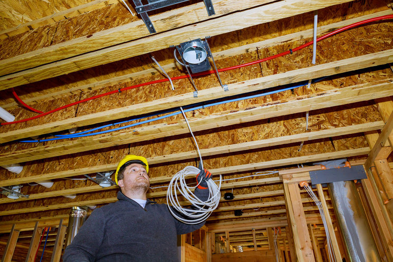 Low angle view of man working on ceiling