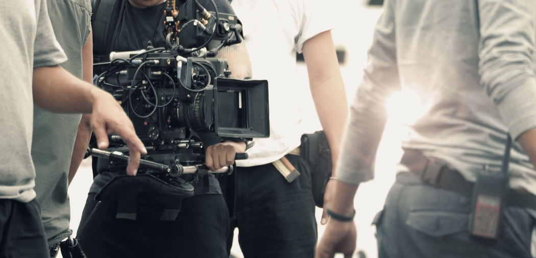 Photographers using movie camera