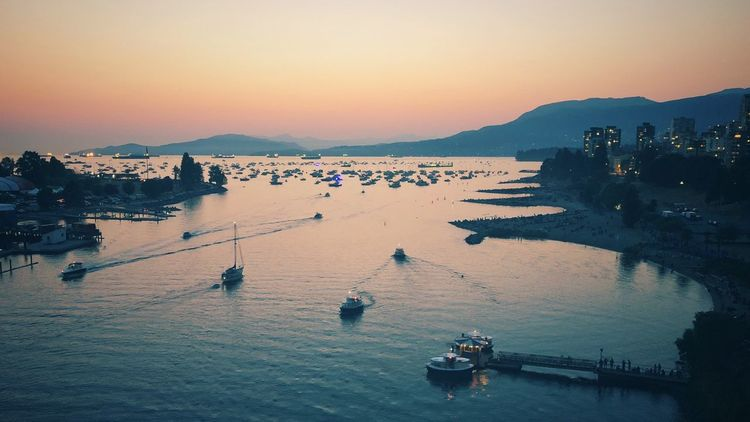 Sunset with mountains and ocean with sailboats Ocean Sunset_collection Sunset Mountains And Sky Mountains Sailboats Water Sky Sunset Sea Nautical Vessel Nature Land Beach Transportation Beauty In Nature Dusk High Angle View Scenics - Nature City Travel