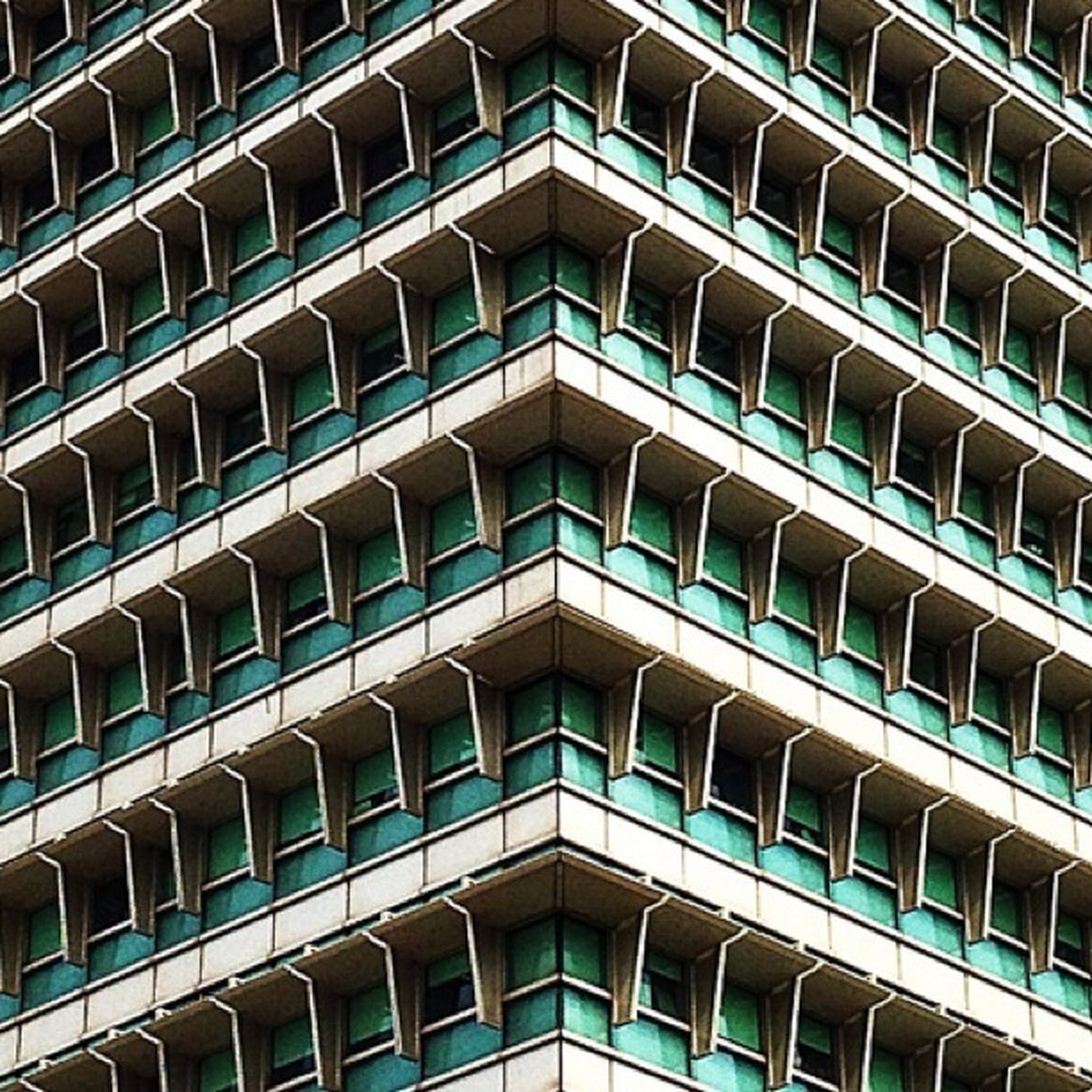 architecture, building exterior, built structure, low angle view, modern, window, city, office building, full frame, repetition, glass - material, building, reflection, backgrounds, pattern, skyscraper, tall - high, in a row, architectural feature, facade