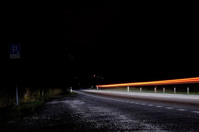 Just Carlights Transportation Light Trail Night Road Speed Long Exposure Motion The Way Forward Illuminated No People Blurred Motion Outdoors Clear Sky Road Sign High Street