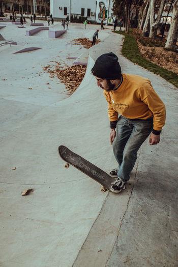 Full length of man skateboarding on skateboard