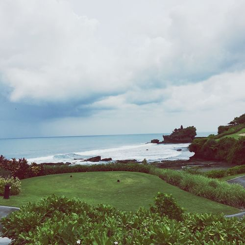 Sea Horizon Over Water Water Tranquil Scene Grass Tranquility Scenics Sky Landscape Cloud - Sky Beauty In Nature Travel Destinations Cloud Tourism Vacations Ocean Non-urban Scene Nature Solitude Distant Tanah Lot
