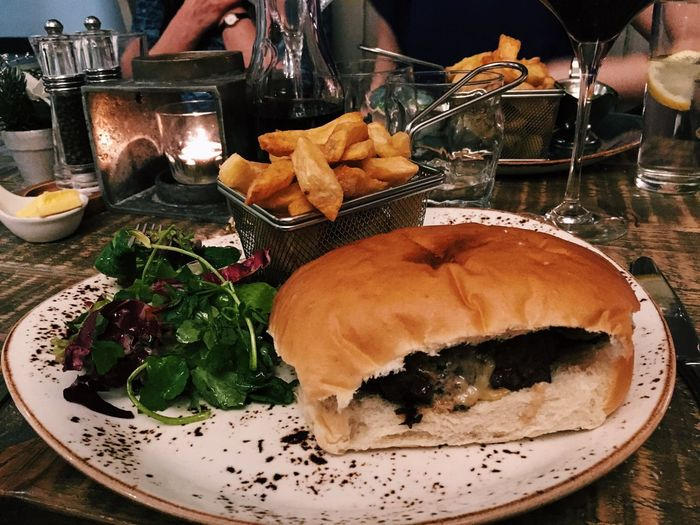 Venison burger and chips. Food And Drink Food Table Freshness Plate Real People Human Body Part Ready-to-eat Indoors  Indulgence Serving Size Meal Restaurant Unhealthy Eating Temptation Human Hand Meat Cooked Sandwich Gourmet Venison  Burger Time
