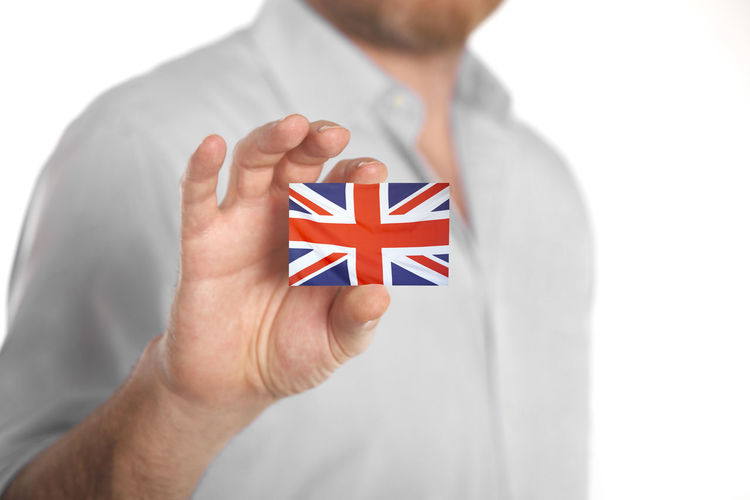 Human Hand One Person Hand Patriotism Holding Flag Human Body Part Studio Shot White Background Close-up Men Indoors  White Color Adult Front View Red Finger Uk United Kingdom