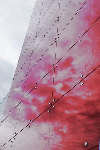 Building Exterior Close-up Cloud - Sky Day Low Angle View No People Outdoors Red Tiles Red Wall Red Wall Reflections Shiny Tiles Shiny Wall Sky Wall