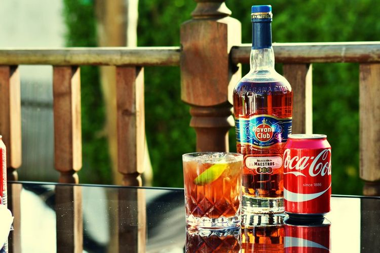 Enjoying a summers day creating new cocktails and taking photos but I'll always enjoy a simple cuba libre Bottle Drink Refreshment Focus On Foreground Alcohol Food And Drink No People Table Freshness Close-up Lifestyles Cocktails Fullcolor Havana Rum Cuba Libre Simple EyeEmNewHere