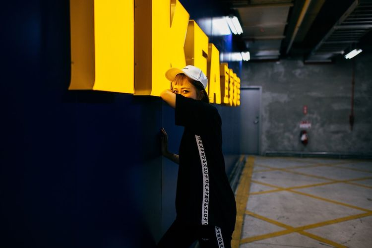 Young woman standing in corridor