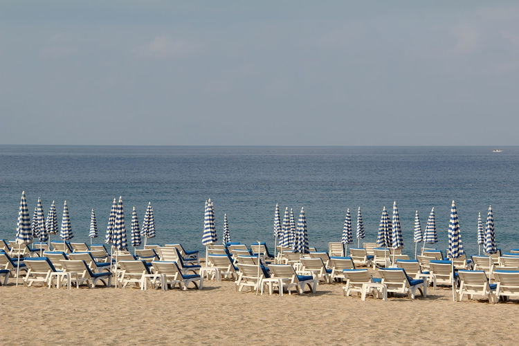 Chair Water Sea Beach Land Horizon Over Water Sky Seat Horizon Nature Beauty In Nature Tranquility Tranquil Scene Lounge Chair Scenics - Nature In A Row Sand Absence Deck Chair No People Outdoors Outdoor Chair Travel Alanya Turkey