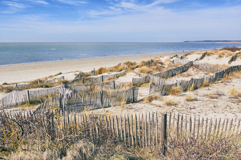Barriers in the dunes, sea and beach of the Pas-de-Calais in France Barriers Beach Beach Of France Beauty In Nature Blue Sky Day Dunes Good Weather Grass Holiday Horizon Over Water La Manche Nature No People Outdoors Scenics Sea Seascape Sky Summer Tranquil Scene Tranquility Water The Great Outdoors - 2018 EyeEm Awards