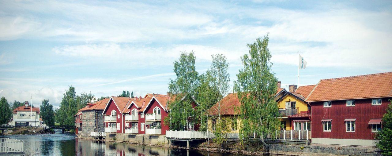 Houses against cloudy sky