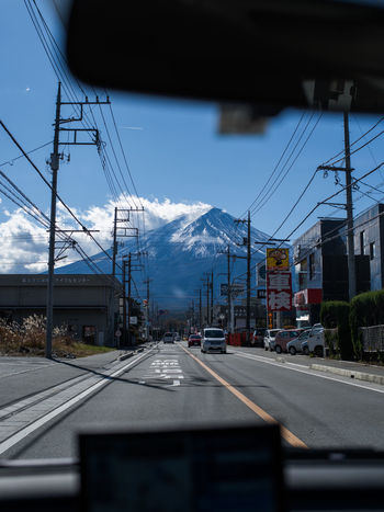 Driving towards mt fuji, Japan Driving Japan Mt Fuji Architecture Built Structure Cable Car City Cloud - Sky Connection Day Electricity  Electricity Pylon Fujiyama Land Vehicle Mode Of Transport Mtfuji No People Outdoors Power Line  Power Supply Railroad Track Road Sky Transportation