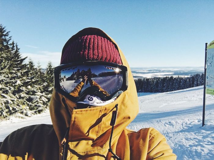 Clear Sky Cold Temperature Day Front View Headshot Landscape Leisure Activity Lifestyles Looking At Camera Nature One Person Outdoors Portrait Real People Ski Goggles Ski Holiday Skiing Sky Snow Snowboarding Standing Sunlight Vacations Warm Clothing Winter