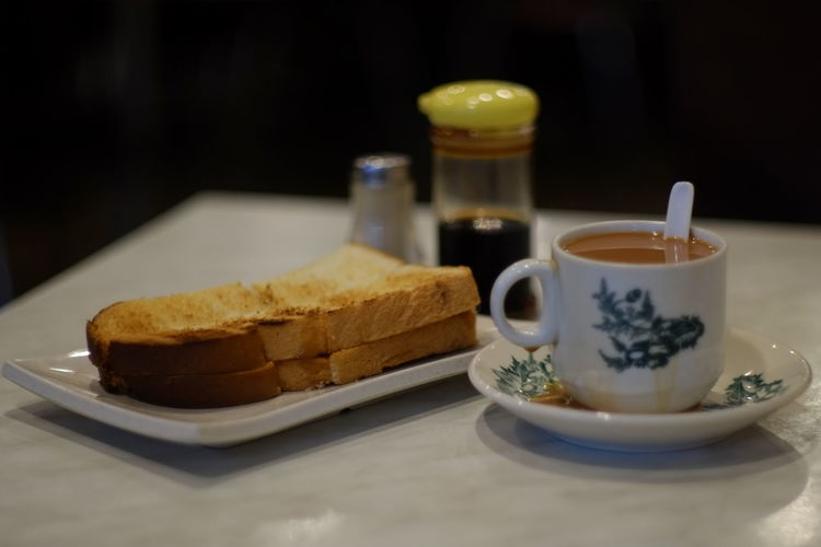 The best home made kaya butter with charcoal gril bread and the best hainan tea.Always Be Cozy Food Food And Drink Toasted Bread Fujifilm XE1 Yik Mun Pau Tanjung Malim Malaysia