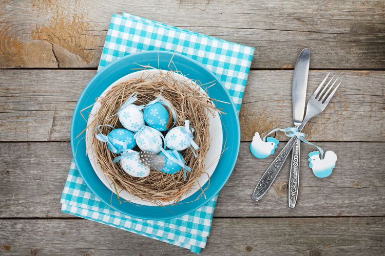 Directly above shot of easter eggs in plate on table