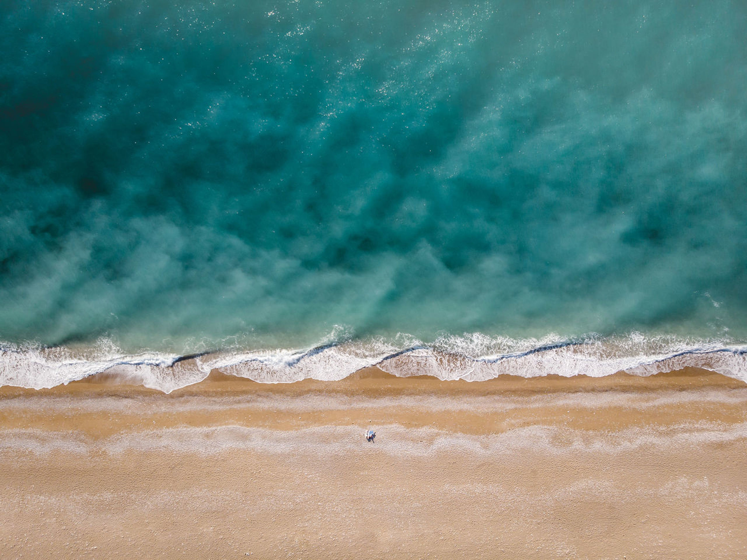land, wave, water, beach, sea, sport, nature, beauty in nature, aquatic sport, motion, surfing, day, scenics - nature, sand, tranquility, outdoors, tranquil scene, high angle view, power in nature