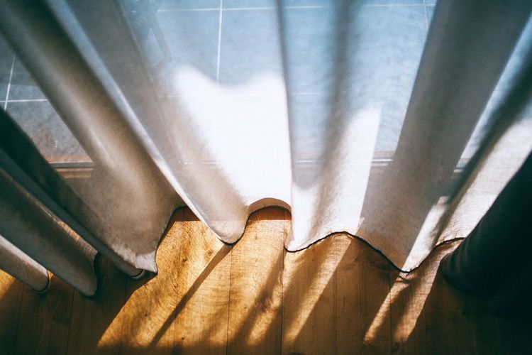 High angle view of curtain on window